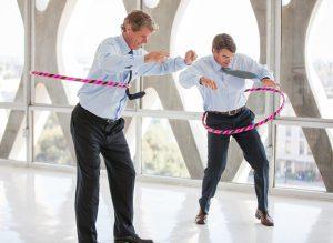 Male leaders hula hooping